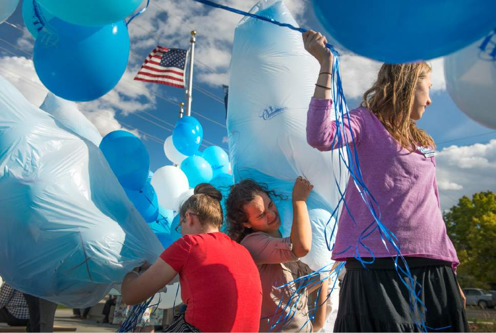 Leah Hogsten  |  The Salt Lake Tribune l-r Cottonwood Heights  youth city council members Alissa Boyack, Nicole Cunningham and Lareesa Sumsion wrangle balloons for the ceremony. Cottonwood Heights City Hall officials, dignitaries and residents celebrated its official opening with an open house and ribbon cutting September, 29, 2016.