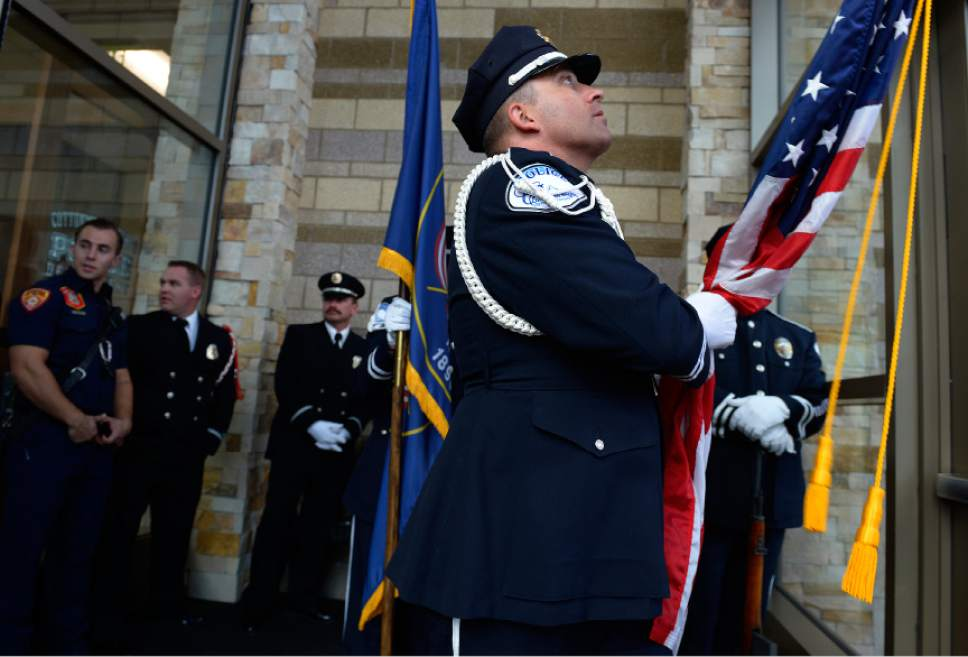 Leah Hogsten  |  The Salt Lake Tribune Cottonwood Heights Police officer Jeff Potter leads the color guard prior to the ceremony. Cottonwood Heights City Hall officials, dignitaries and residents celebrated its official opening with an open house and ribbon cutting September 29, 2016.