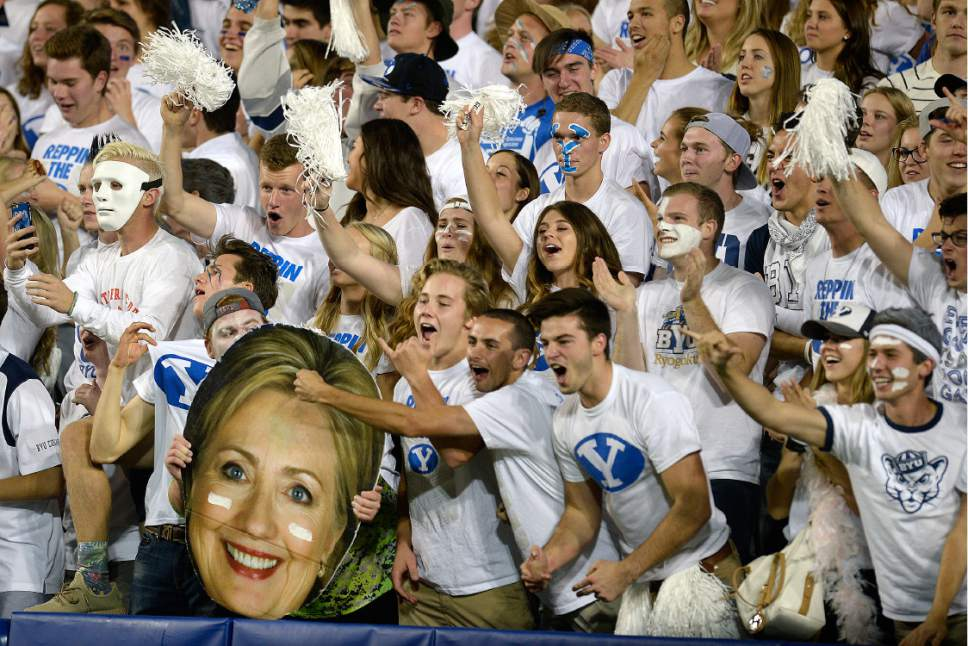 Scott Sommerdorf   |  The Salt Lake Tribune   BYU fans celebrate with a cutout of Hillary Clinton as BYU led Toledo 21-14 at the end of the 1st quarter, Friday, September 30, 2016.