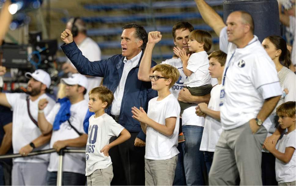 Scott Sommerdorf   |  The Salt Lake Tribune   BYU alum Mitt Romney sings the BYU fight song during pre-game ceremonies. BYU led Toledo 21-14 at the end of the 1st quarter, Friday, September 30, 2016.