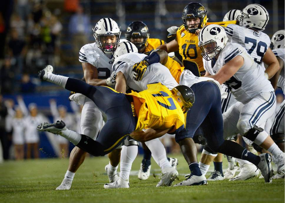 Scott Sommerdorf   |  The Salt Lake Tribune   Toledo Rockets linebacker Tyler Taafe (17) flies through to sack BYU QB Taysom Hill late in the first half. BYU and Toledo were tied 21-21 at the half, Friday, September 30, 2016.