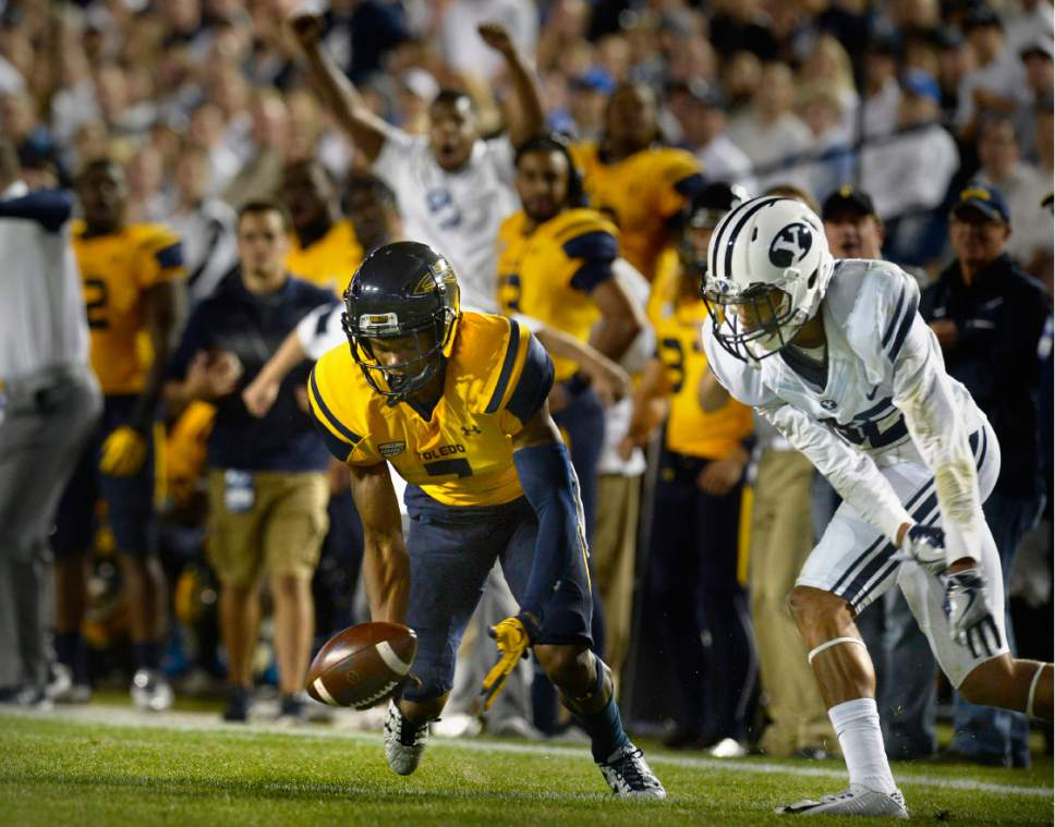 Scott Sommerdorf   |  The Salt Lake Tribune   Toledo Rockets wide receiver Jon'Vea Johnson (7) drops a pass late in the first half with BYU defensive back Chris Wilcox (32) defending during first half play. BYU and Toledo were tied 21-21 at the half, Friday, September 30, 2016.