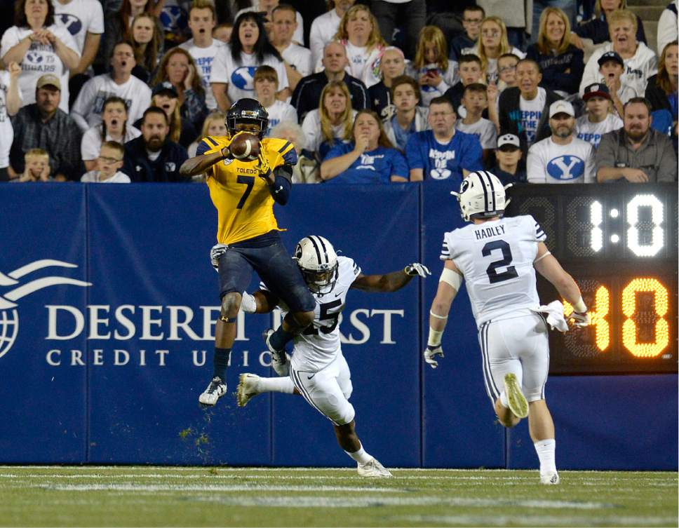 Scott Sommerdorf   |  The Salt Lake Tribune   Toledo Rockets wide receiver Jon'Vea Johnson (7) catches a TD pass to give Toldeo a 38-35 lead over BYU in the third quarter. BYU defeated Toledo 55-53, Friday, September 30, 2016.
