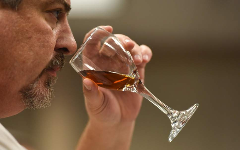 Francisco Kjolseth | The Salt Lake Tribune George Gamvroulas, an employee of the Cottonwood Heights liquor store, smells the aroma of a sherry during a recent wine training class sponsored by the DABC. The Utah Department of Alcoholic Beverage Control got funding from the 2016 legislature for the training, something the public has been demanding for many years.