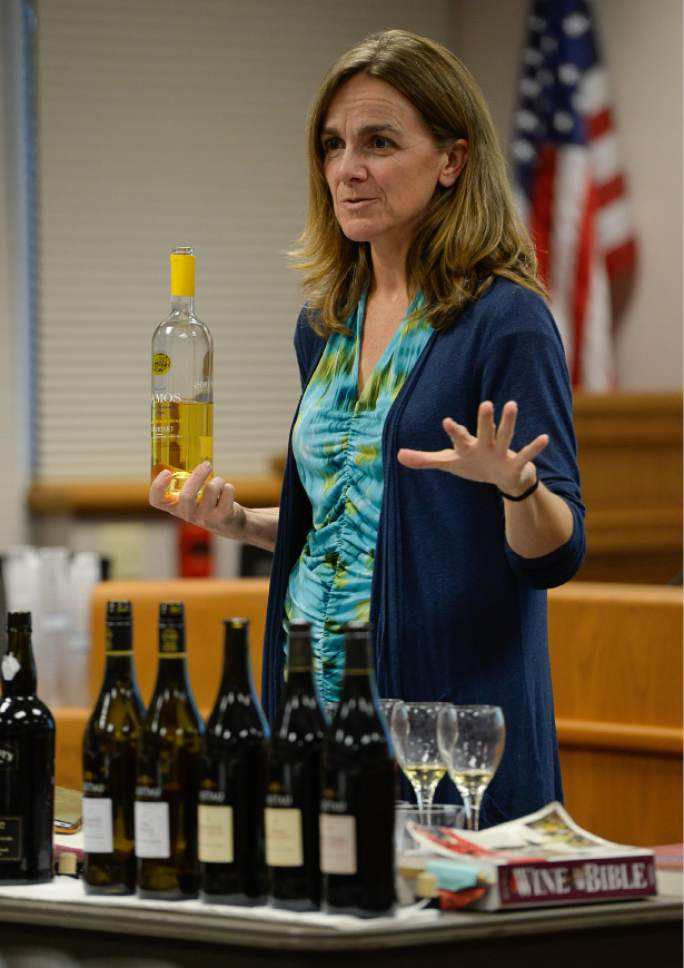Francisco Kjolseth | The Salt Lake Tribune Wendy Caron, a certified wine educator who was hired to teach an eight-week wine training class, discusses several wines during a recent meeting. The DABC just started the class for Utah's liquor store employees. The Utah Department of Alcoholic Beverage Control got funding from the 2016 legislature for the training, something the public has been demanding for many years.