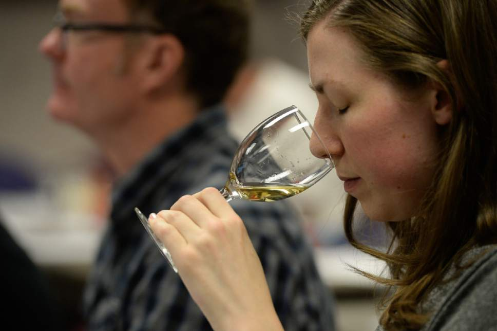 Francisco Kjolseth | The Salt Lake Tribune Jessica Mitchell, an employee of the Wine Store in Salt Lake, focuses her nose on the aroma of a wine during a wine training class that the DABC just started for Utah's liquor store employees. The Utah Department of Alcoholic Beverage Control got funding from the 2016 legislature for the training, something the public has been demanding for many years.