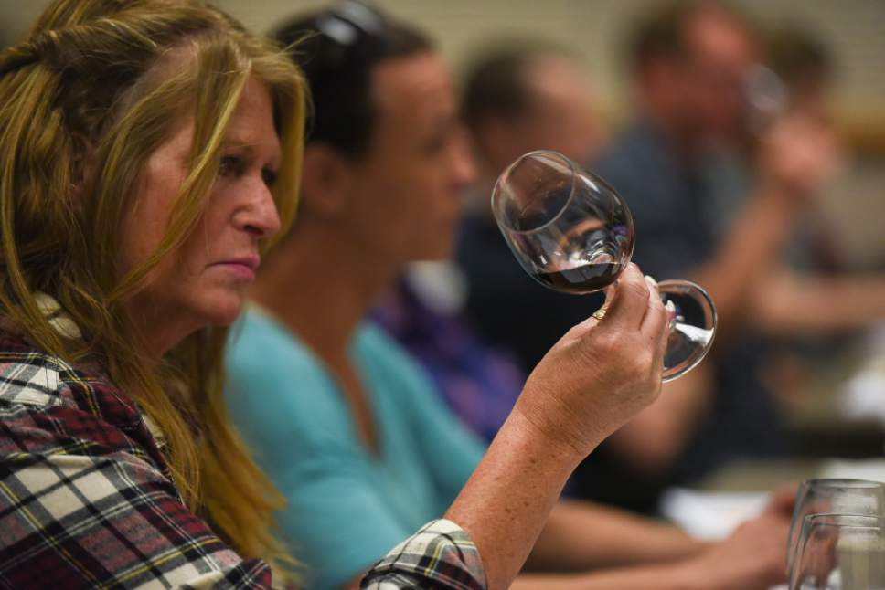 Francisco Kjolseth | The Salt Lake Tribune Kathleen Jacobson, store manager for the liquor store in Sandy, makes a visual check on a sampled wine as part of a new wine training class that the DABC just started for Utah's liquor store employees.