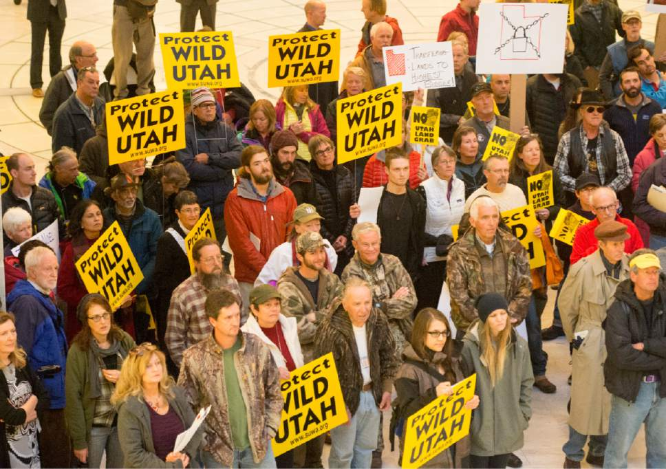 Rick Egan  |  The Salt Lake Tribune  Lawmakers and environmental and public lands advocates rally against the public lands transfer in the capitol rotunda, Monday, March 2, 2015