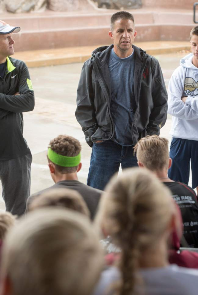 Rick Egan  |  The Salt Lake Tribune  Herman High School cross country coach, James Barnes, talks to his team during practice. Barnes saved several of his players from an oncoming truck. Monday, October 3, 2016.