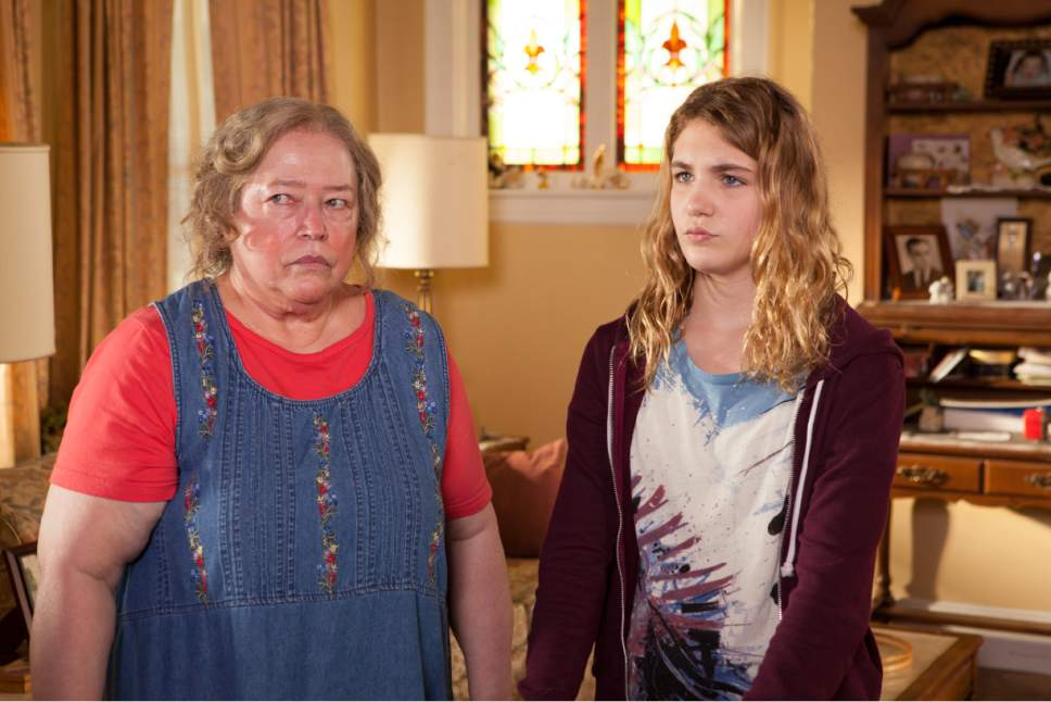 """Mamie Trotter (Kathy Bates, left) protects Gilly (Sophie Nelisse), her new foster child, in the family drama """"The Great Gilly Hopkins."""" Courtesy Lionsgate Premiere"""