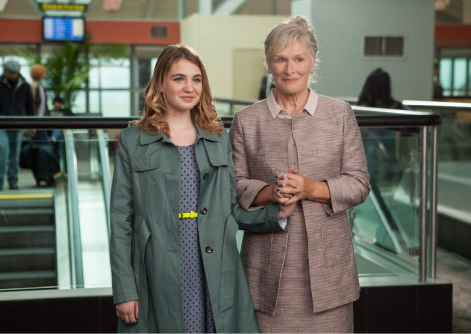 """Gilly (Sophie Nelisse, left) and her grandmother Nonnie (Glenn Close) wait at the airport to meet Gilly's wayward mom, in the family drama """"The Great Gilly Hopkins."""" Courtesy Lionsgate Premiere"""
