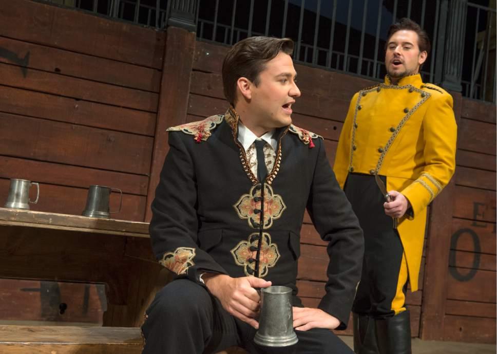 "Leah Hogsten  |  The Salt Lake Tribune In Utah Opera's ""Carmen,"" from left, baritone Christian Bowers is Escamillo, and tenor Dominick Chenes is Don Jose. The popular Bizet opera opens the company's season Saturday, Oct. 8."