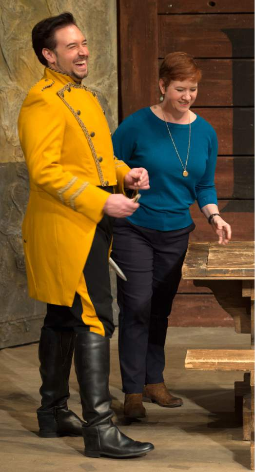"""Leah Hogsten     The Salt Lake Tribune Dominick Chenes, from left, who plays Don Jose, the mentally unstable soldier in Utah Opera's production of """"Carmen,"""" shares a laugh with director Tara Faircloth."""