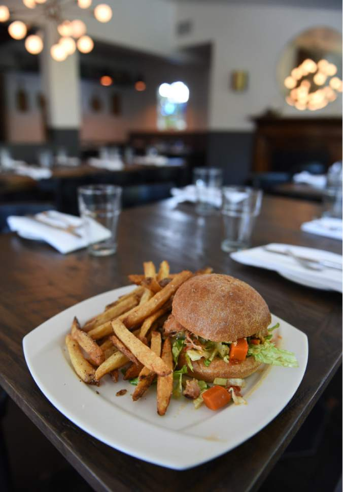 Francisco Kjolseth | The Salt Lake Tribune Paprikash chicken, romaine, pickled onion and citrus yogurt from Trestle Tavern, a Salt Lake City neighborhood restaurant with Eastern-European style food that has moved in to the former location of Fresco in the 15th &15th area.
