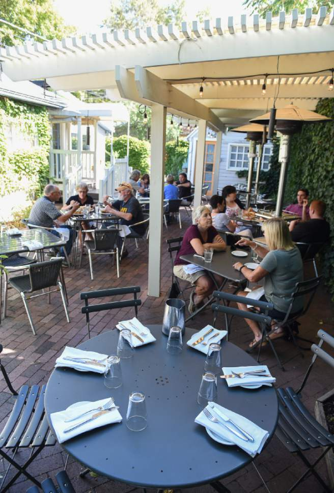 Francisco Kjolseth | The Salt Lake Tribune The lunch crowd enjoys the patio seating at Trestle Tavern, a Salt Lake City neighborhood restaurant with Eastern-European style food that has moved in to the former location of Fresco in the 15th &15th area.