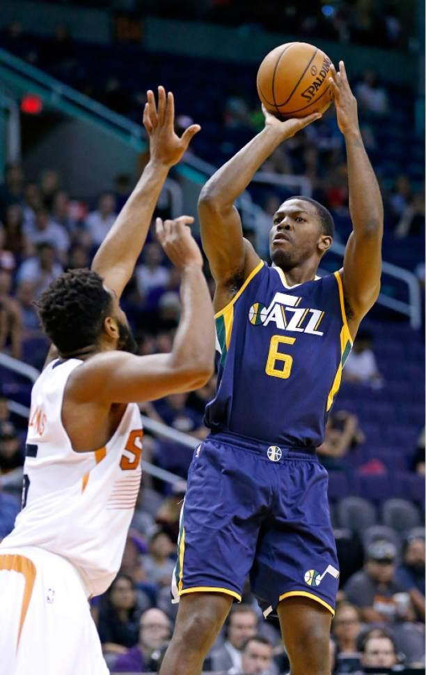 Utah Jazz's Joe Johnson (6) shoots over Phoenix Suns' Alan Williams, left, during the first half of an NBA preseason basketball game Wednesday, Oct. 5, 2016, in Phoenix. (AP Photo/Ross D. Franklin)
