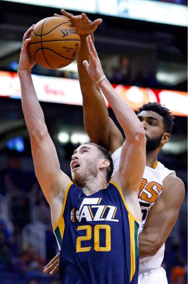Utah Jazz's Gordon Hayward (20) gets fouled by Phoenix Suns' Alan Williams, right, during the first half of an NBA preseason basketball game Wednesday, Oct. 5, 2016, in Phoenix. (AP Photo/Ross D. Franklin)