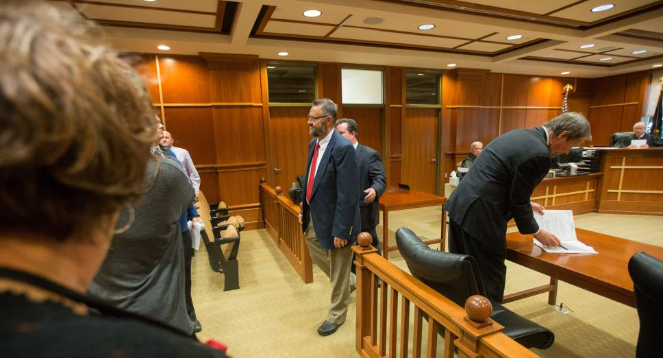 Scott Winterton  |  Pool West Jordan city councilman Jeffery David Haaga and his attorney Tyler Ayres leave the court judge Judge Clinton E. Balmforth in South Jordan Justice Court on Friday, Oct. 7, 2016.
