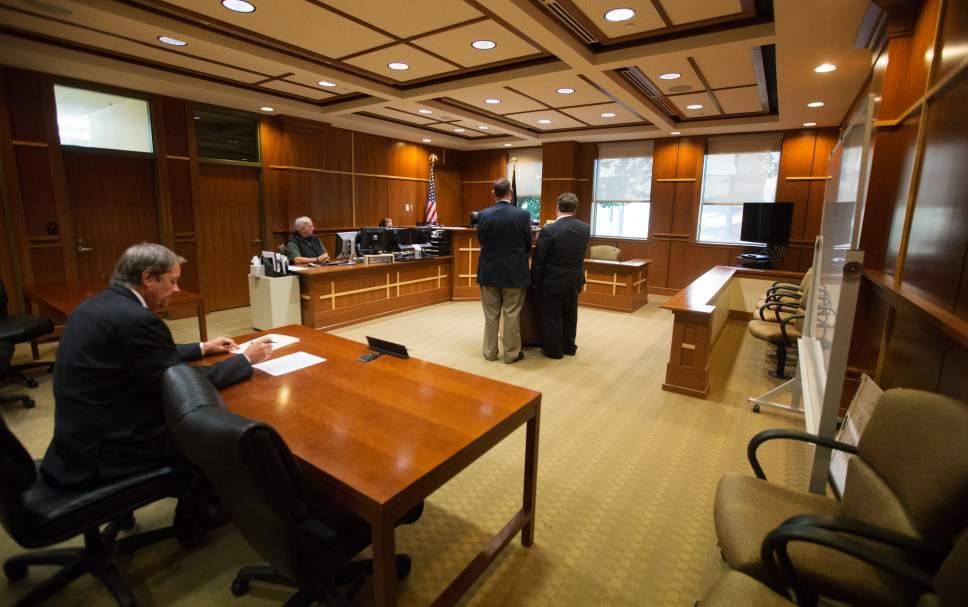 Scott Winterton  |  Pool West Jordan city councilman Jeffery David Haaga and his attorney Tyler Ayres appear before judge Judge Clinton E. Balmforth in South Jordan Justice Court on Friday, Oct. 7, 2016.
