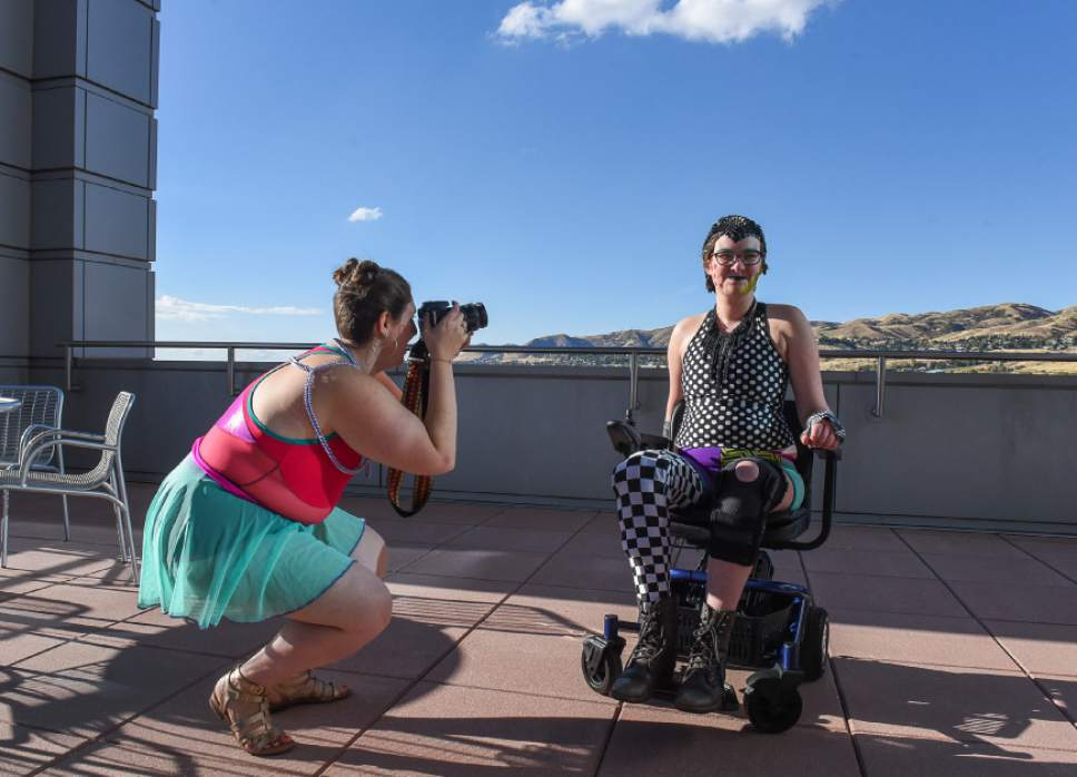 Francisco Kjolseth  |  The Salt Lake Tribune  Nina Litoff records the transformation of Jae M. who says sometimes she feels like a medical supply store because of her condition. When she found out about the queer crip fashion show she jumped at the opportunity to participate in the event as part of LGBT Pride Week.