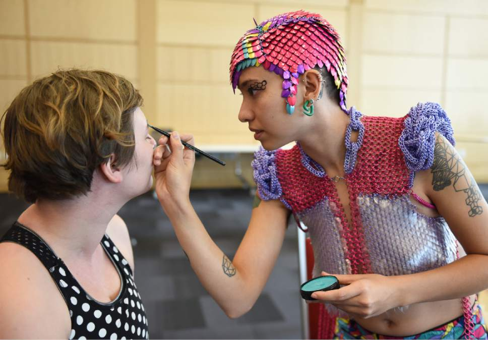Francisco Kjolseth  |  The Salt Lake Tribune  Artist Sky Cubacub, creator of Rebirth Garments applies makeup to Jae M. in preparation for the queer crip fashion show, a politicized umbrella term that encompasses queer, gender, nonconforming identities, that took place at the University of Utah as part of LGBT Pride Week. Local models, outfitted by the works of Cubacub created a clothing line for the full spectrum of genders, size and ability as part of her queer crip dress reform movement manifesto called Radical Visibility.
