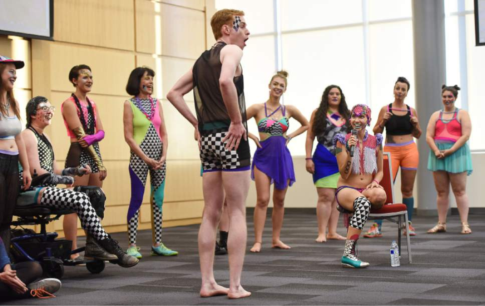Francisco Kjolseth | The Salt Lake Tribune  Artist Sky Cubacub, in chair, creator of Rebirth Garments, explains the clothes worn by Andrew Hayes during a celebration of diversity as part of the queer crip fashion show, a politicized umbrella term that encompasses queer, gender, nonconforming identities, that took place at the University of Utah as part of LGBT Pride Week.