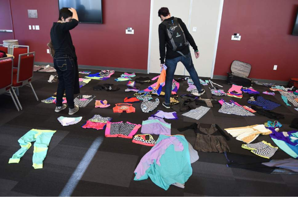 Francisco Kjolseth | The Salt Lake Tribune  Students take a moment to pick an outfit to model for the queer crip fashion show, a politicized umbrella term that encompasses queer, gender nonconforming identities, takes place at the University of Utah as part of LGBT Pride Week.