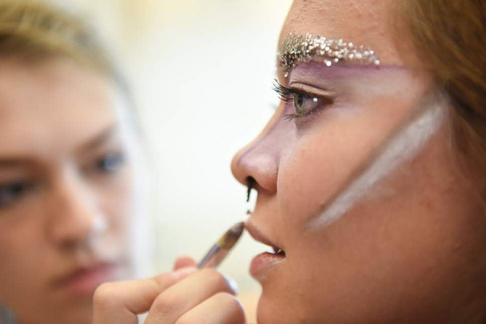 Francisco Kjolseth | The Salt Lake Tribune  Morgan Werder, left, applies makeup to Cat Gonce as they prepare for the queer crip fashion show, a politicized umbrella term that encompasses queer, gender nonconforming identities, takes place at the University of Utah as part of LGBT Pride Week. Local students model clothes by Sky Cubacub, who takes into consideration visible and invisible disabilities and disorders, physical, mental, developmental or emotional conditions as part of her queer crip dress reform movement manifesto called Radical Visibility.