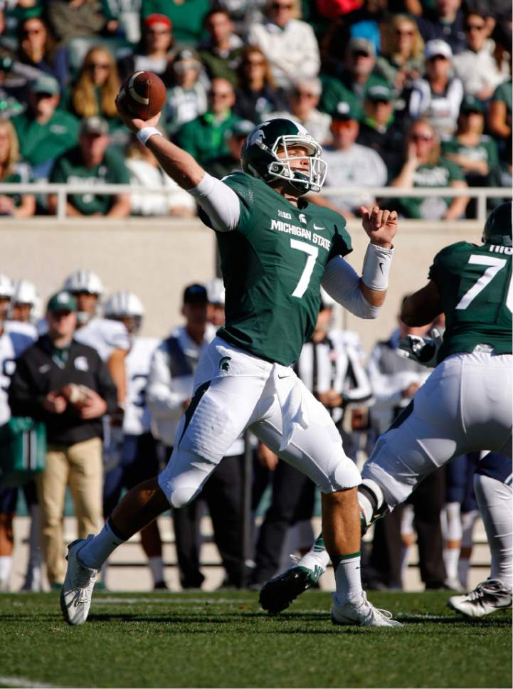 Michigan State quarterback Tyler O'Connor throws a pass against BYU during the first quarter of an NCAA college football game, Saturday, Oct. 8, 2016, in East Lansing, Mich. (AP Photo/Al Goldis)