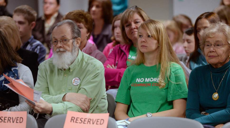 Al Hartmann  |  The Salt Lake Tribune Parents with their children wearing green shirts who are opposed  to Common Core, No Child Left Behind and statewide testing attend the Utah State School Board Meeting in Salt Lake City Friday Feb. 6.  The group is speaking out against federal overreach into education while Gov. Gary Herbert meets with the State School Board.