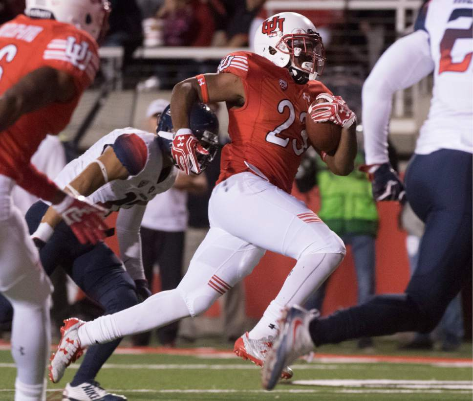 Rick Egan  |  The Salt Lake Tribune  Utah Utes running back Armand Shyne (23) runs for a third quarter touchdown  in PAC-12 football action, Utah vs. The Arizona Wildcats, at Rice-Eccles Stadium, Saturday, October 8, 2016.