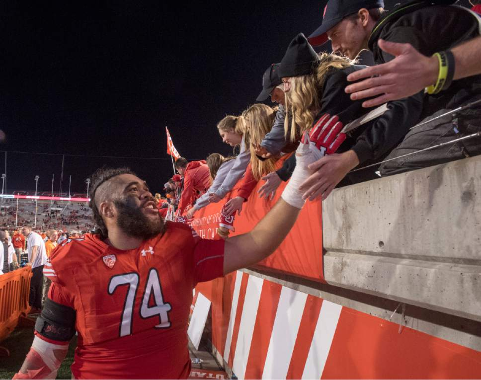 Rick Egan  |  Tribune file photo  Utah offensive lineman Salesi Uhatafe (74) high-fives fans after the Utes, 36-23 win over Arizona, in PAC-12 football action, at Rice-Eccles Stadium, Saturday, October 8, 2016.