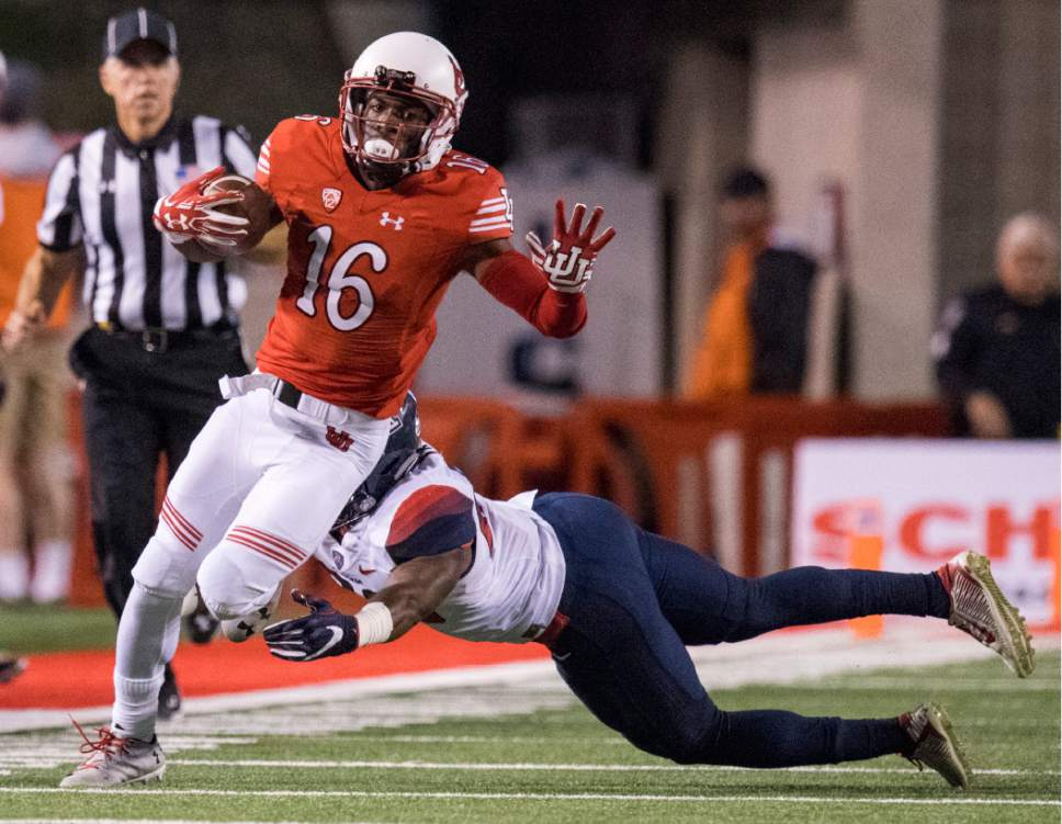 Rick Egan  |  The Salt Lake Tribune  Utah wide receiver Cory Butler-Byrd (16) gets past the Arizona defender, as he runs for the Utes, in PAC-12 football action, Utah vs. The Arizona Wildcats, at Rice-Eccles Stadium, Saturday, October 8, 2016.