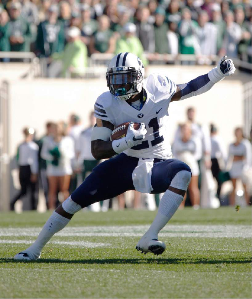 BYU's Jamaal Williams rushes against Michigan State during the first quarter of an NCAA college football game, Saturday, Oct. 8, 2016, in East Lansing, Mich. (AP Photo/Al Goldis)