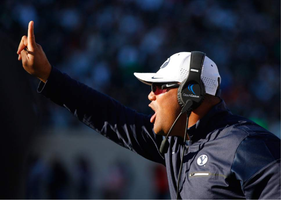 BYU coach Kalani Sitake signals during the second quarter of an NCAA college football game against Michigan State, Saturday, Oct. 8, 2016, in East Lansing, Mich. BYU won 31-14. (AP Photo/Al Goldis)