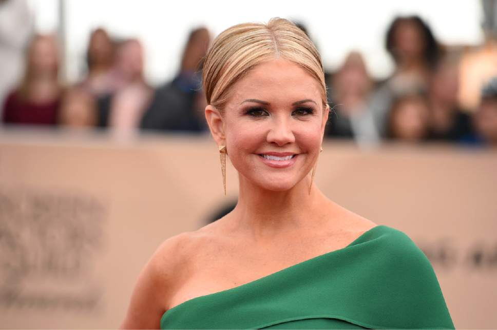 Nancy O'Dell arrives at the 22nd annual Screen Actors Guild Awards at the Shrine Auditorium & Expo Hall on Saturday, Jan. 30, 2016, in Los Angeles. (Photo by Jordan Strauss/Invision/AP)