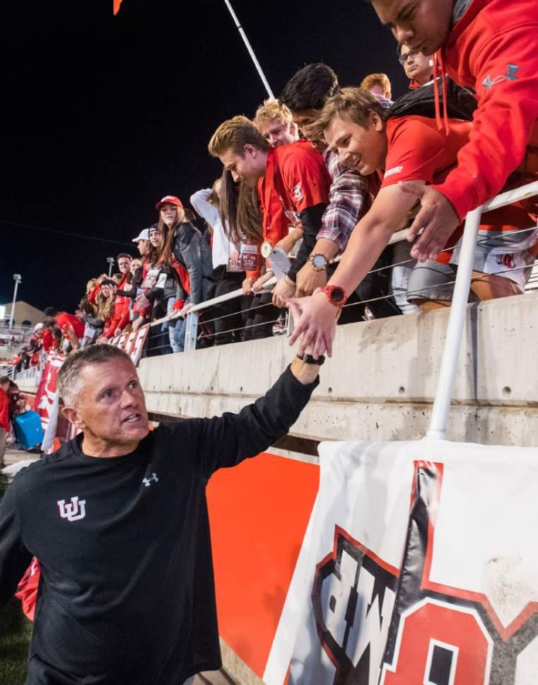Rick Egan  |  The Salt Lake Tribune  Utah Utes head coach Kyle Whittingham high-fives fans after his 100th win, in PAC-12 football action, Utah vs. The Arizona Wildcats, at Rice-Eccles Stadium, Saturday, October 8, 2016.