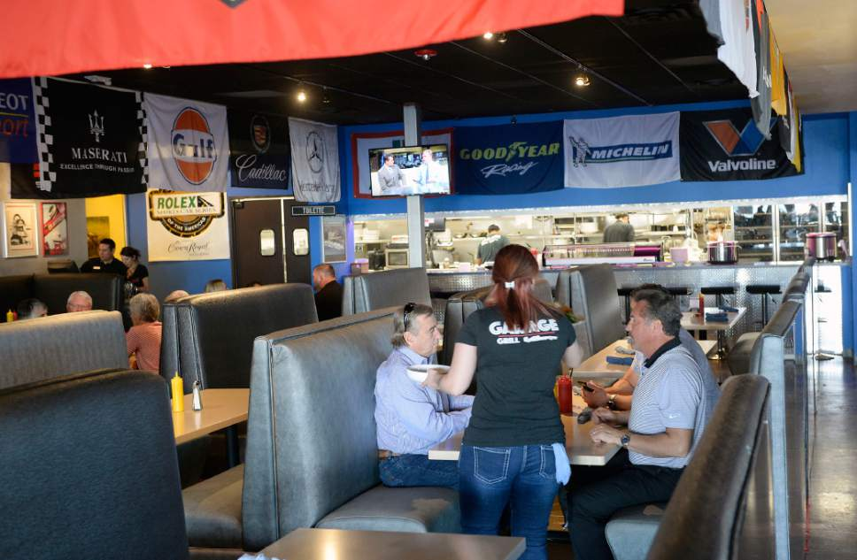 Al Hartmann  |  The Salt Lake Tribune Garage Grill in Draper serves up brew pub fare and RPM Brewery beers alongside race cars and hot rods.