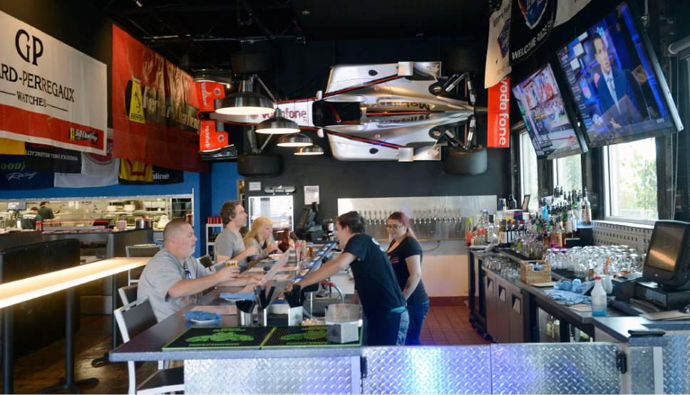 Al Hartmann  |  The Salt Lake Tribune Garage Grill in Draper serves up brew pub fare and RPM Brewery beers alongside race cars and hot rods. It has a full-service bar with beer on tap and mixed drinks.