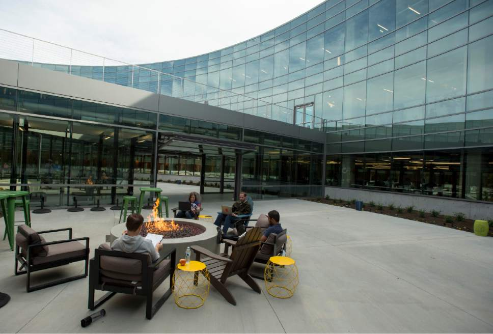 Rick Egan  |  The Salt Lake Tribune  The Overstock.com, Peace Coliseum corporate campus opened Friday. The 231,000-square-foot main office building is located on 19 acres of land at 799 West Coliseum Way in Midvale, was designed to appear from the air as a peace sign (due to the indoor and outdoor pathways intersecting its circular layout), and to appear from ground level as a corporate glass-and-concrete version of the Roman Coliseum.  Thursday, October 13, 2016.