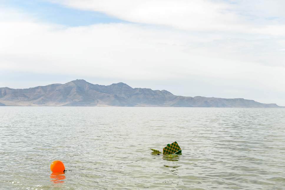 Trent Nelson  |  The Salt Lake Tribune A buoy and anchor are attached to a fixed-wing plane in the Great Salt Lake where it crashed Thursday October 13, 2016.