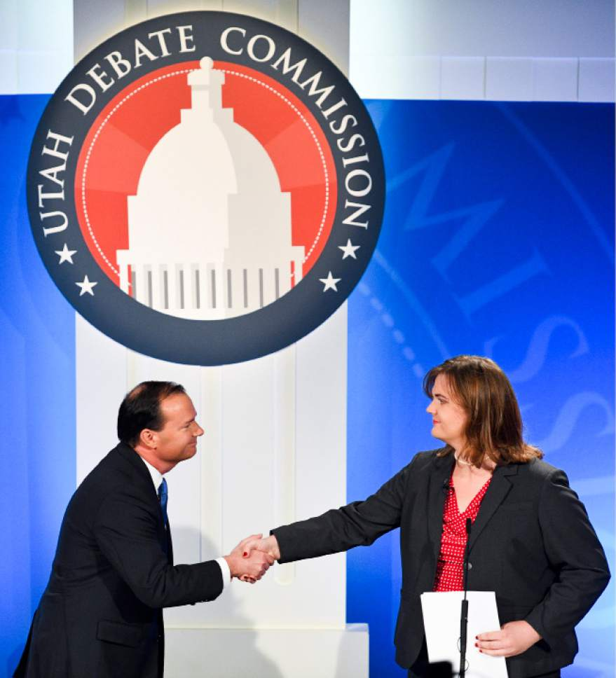 Isaac Hale  |  Pool Photo  Republican candidate Mike Lee shakes hands with Democratic candidate Misty Snow during the U.S. Senate Debate on Wednesday, Oct. 12, 2016 at KBYU studios on the campus of Brigham Young University in Provo.