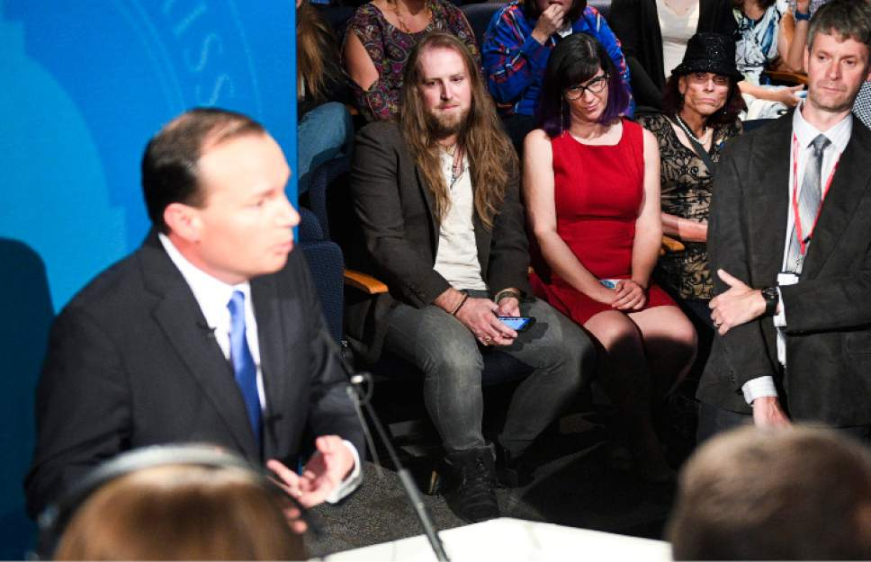 Isaac Hale  |  Pool Photo  Supporters of Democratic candidate Misty Snow watch as Republican candidate Mike Lee speaks to the media after the U.S. Senate Debate on Wednesday, Oct. 12, 2016 at KBYU studios on the campus of Brigham Young University in Provo.