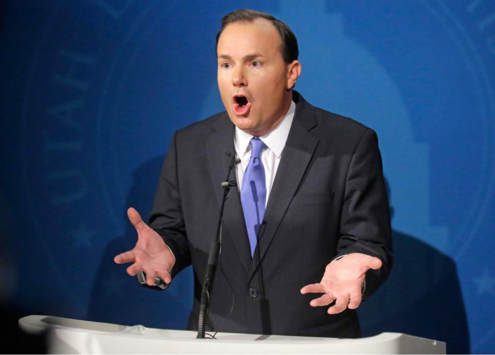 Republican Sen. Mike Lee, speaks with reporters after squaring off in a debate with Democratic challenger Misty Snow at Brigham Young University Wednesday, Oct. 12, 2016, in Provo, Utah. Lee and his Democratic challenger Snow meet Wednesday night in their first and likely only debate this year as Lee, Utah's junior senator, makes his first re-election run. (AP Photo/Rick Bowmer, Pool)