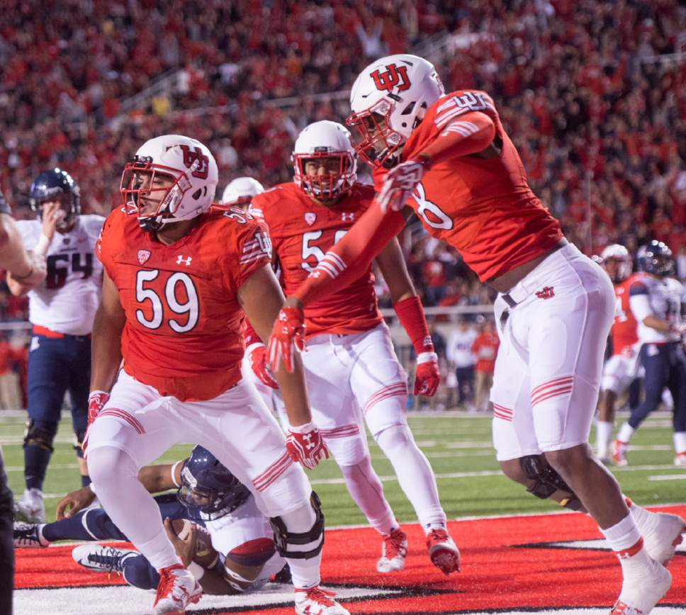 Rick Egan  |  The Salt Lake Tribune  Utah defensive tackle Pasoni Tasini (59) celebrates with his team mates after he sacked Wildcats quarterback Brandon Dawkins (13) in the end zone for a safety, in PAC-12 football action, Utah vs. The Arizona Wildcats, at Rice-Eccles Stadium, Saturday, October 8, 2016.