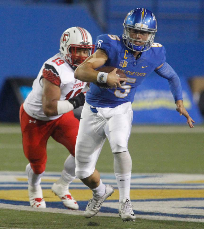 San Jose State's Kenny Potter scrambles for a first down as Utah's Sunia Tauteoli chases during the first half of an NCAA college football game Saturday, Sept. 17, 2016, in San Jose, Calif. (AP Photo/Mathew Sumner)