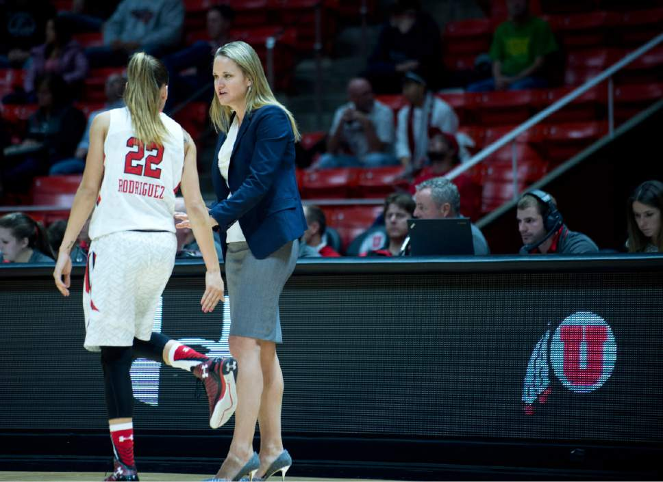 Lennie Mahler  |  The Salt Lake Tribune  Utah's Danielle Rodriguez talks with head coach Lynne Roberts in a game against South Dakota at the Huntsman Center in Salt Lake City, Friday, Nov. 13, 2015.