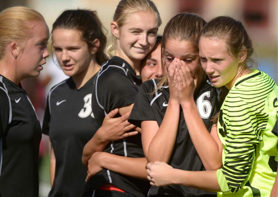 Leah Hogsten  |  The Salt Lake Tribune Stansbury's Emily Franz is comforted after the loss. Logan High School girls soccer team defeated Stansbury High School 5-3 during their state 3A quarterfinals game at Logan, October 15, 2016.