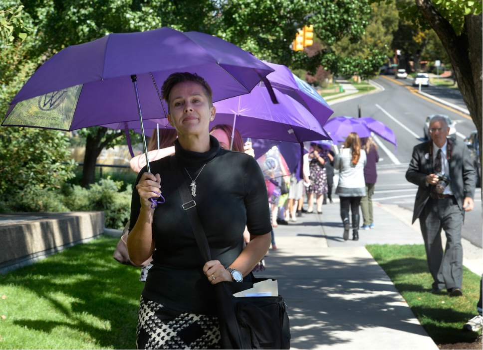 Scott Sommerdorf   |  The Salt Lake Tribune   Debra Jenson leads the Ordain Women group carrying purple umbrellas in march toward the LDS Church Administration Building to request a meeting with a general authority, Saturday, October 1, 2016.