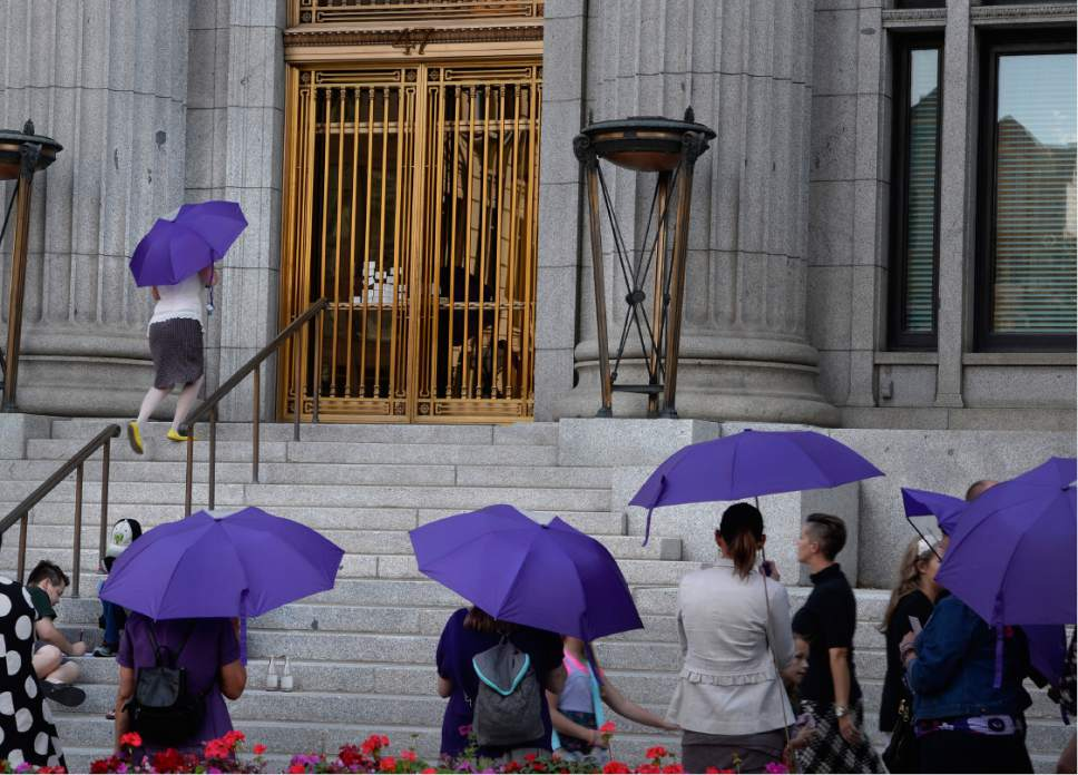 Scott Sommerdorf   |  The Salt Lake Tribune   Members of the Ordain Women group climbed the stairs to try the locked doors of the LDS Church Administration Building as they tried to request a meeting with a general authority, Saturday, October 1, 2016.